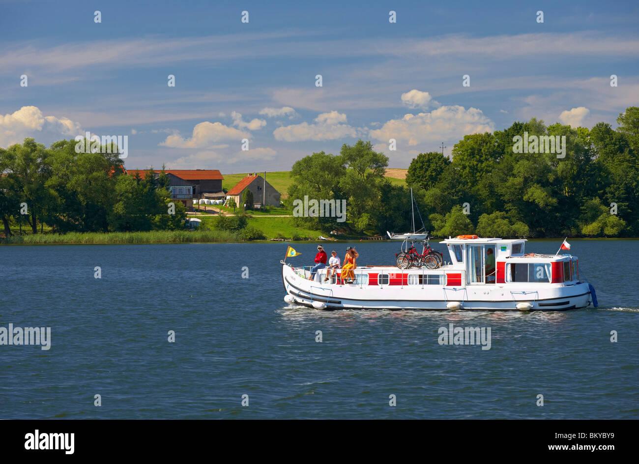 Houseboat on Jezioro Talty (Talter-Gewaesser), Mazurskie Pojezierze, East Prussia, Poland, Europe - Stock Image