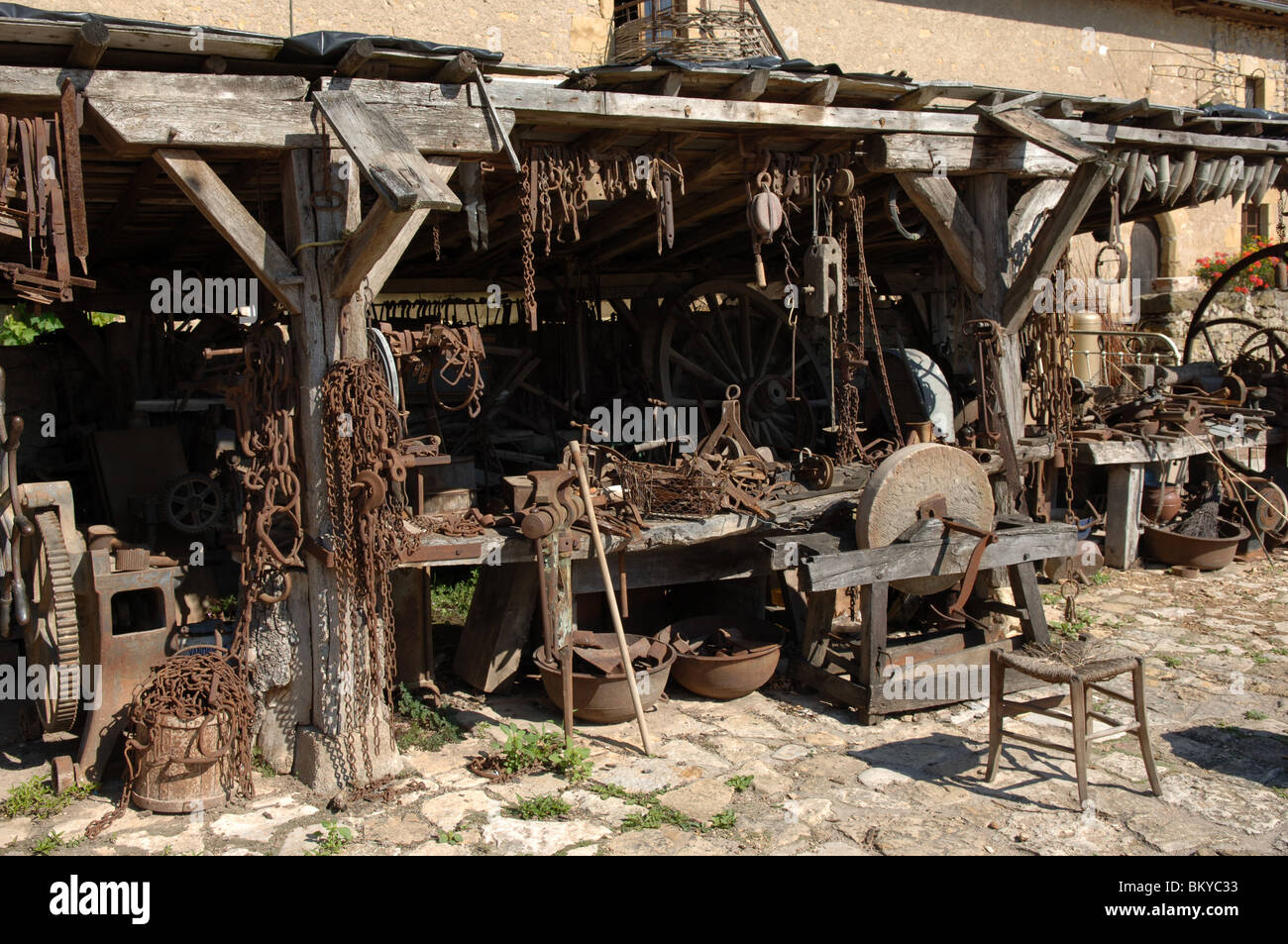 Old implements and machinery in rural France - Stock Image