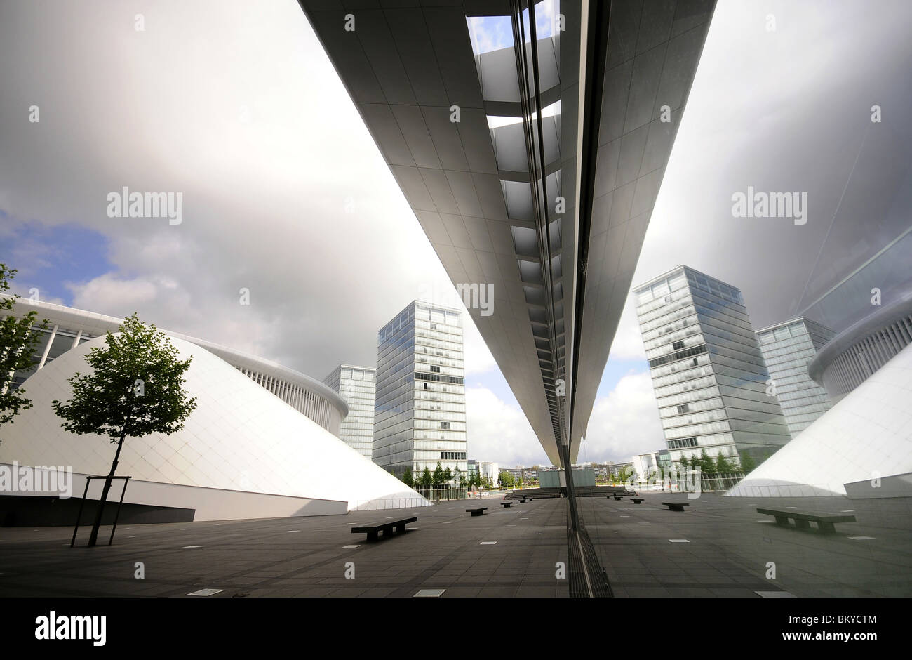 Reflection on the glass front of the Philharmonie on the Kirchberg with european district, City of Luxembourg, Luxembourg, - Stock Image