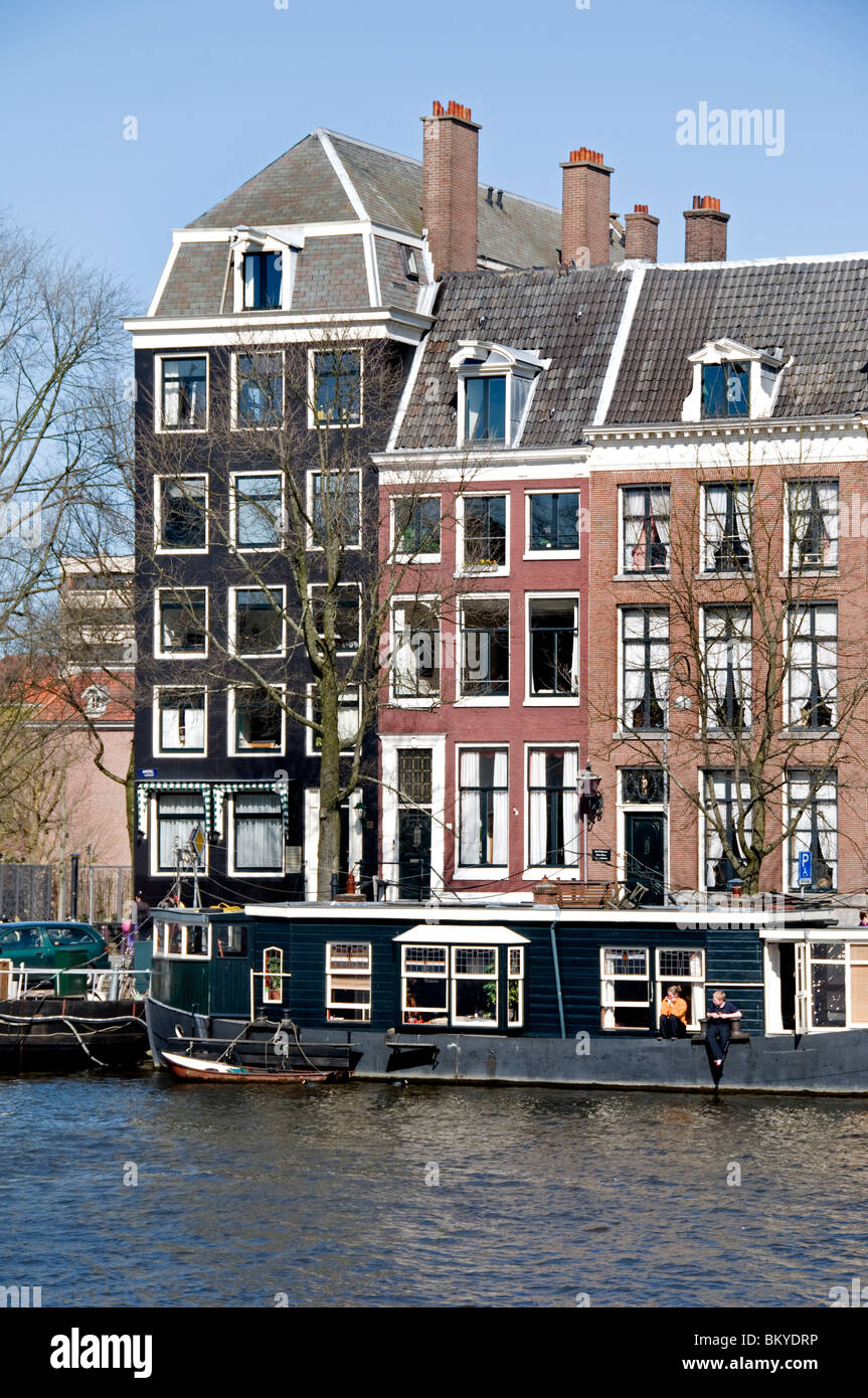 Amsterdam Amstel Canal House Boat The Netherlands Dutch - Stock Image