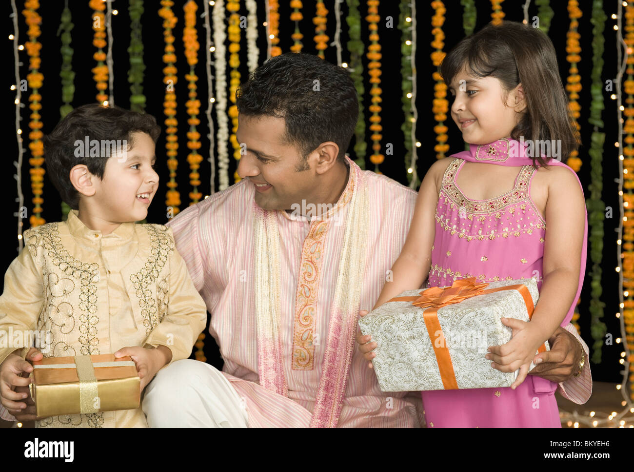 Family holding Diwali gifts Stock Photo: 29492994 - Alamy for Diwali Gifts For Family  113lpg