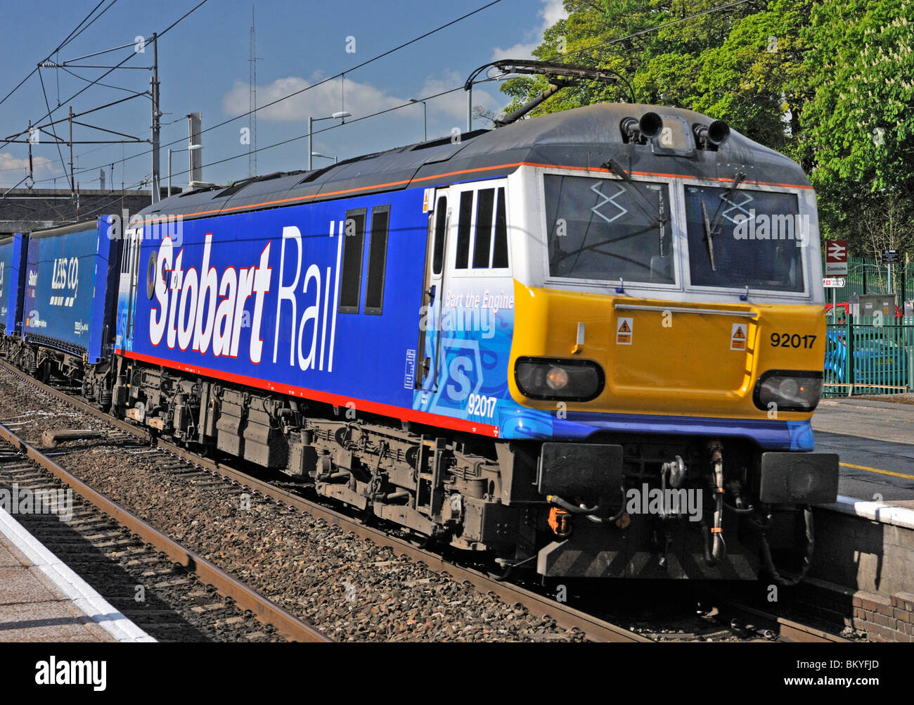 Stobart Rail locomotive No. 92017 'Bart the Engine' hauling Tesco Less CO2 freight. West Coast Main Line. - Stock Image