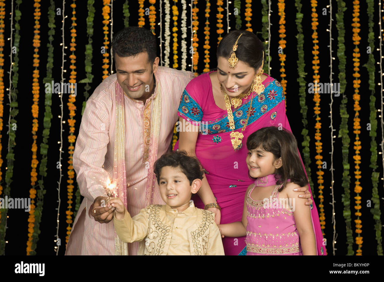 Family celebrating Diwali Stock Photo