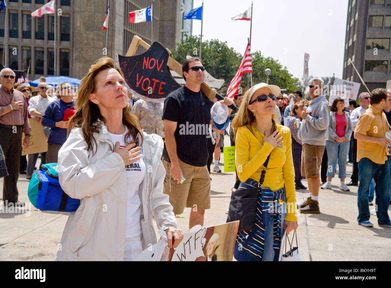 Anti-government protesters recite the Pledge of Allegiance at a 'Tea Party' rally on April 15 (Tax Day) - Stock Image