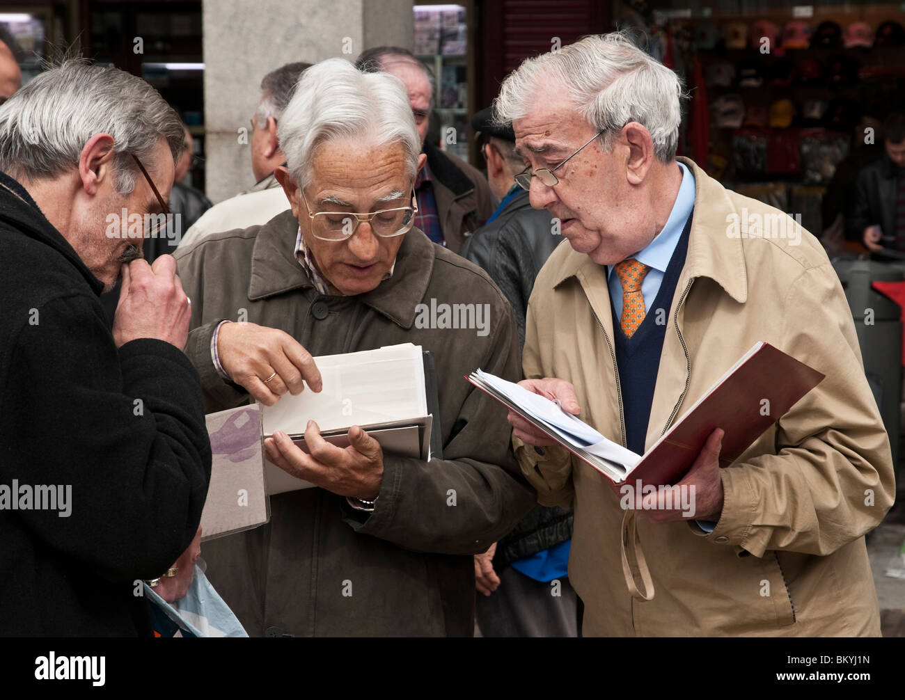 Philatelists, stamp collectors, at the Sunday stamp and coin collectors market in The Plaza Mayor, central Madrid, - Stock Image
