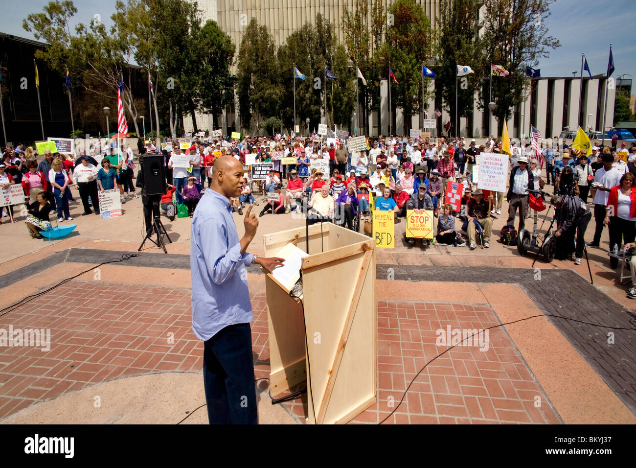 """An angry African American speaker harangues the crowd at a """"Tea Party"""" rally on April 15 (Tax Day) in Santa Ana, Stock Photo"""