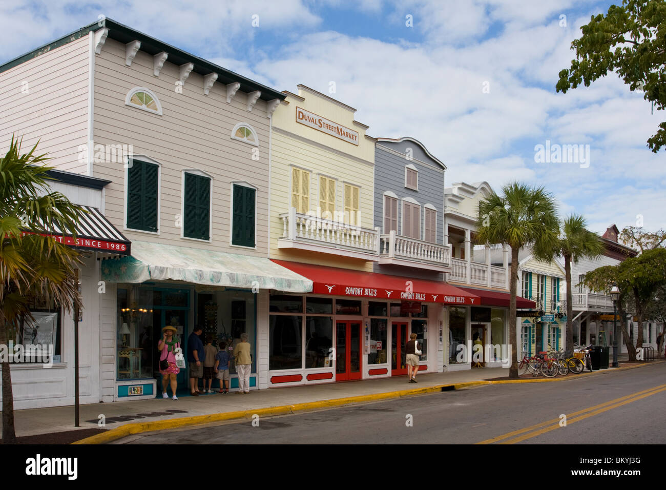 Typical Wood Frame Buildings Of Duval Street Shops In Key West, Florida,  USA.