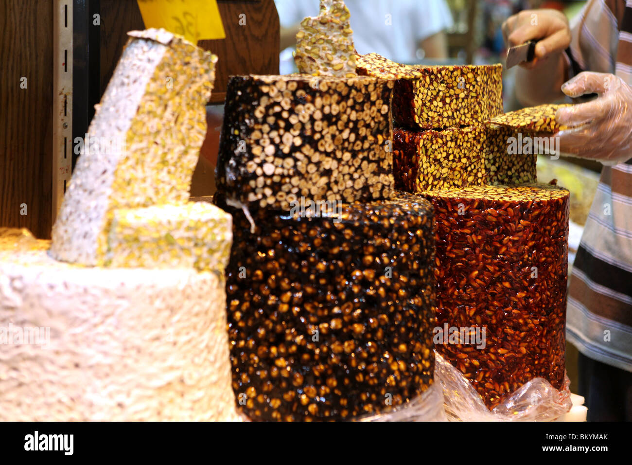 Halva sweets with pistachios on display at the Spice Bazaar, Sultanahmet, Istanbul, Turkey. - Stock Image