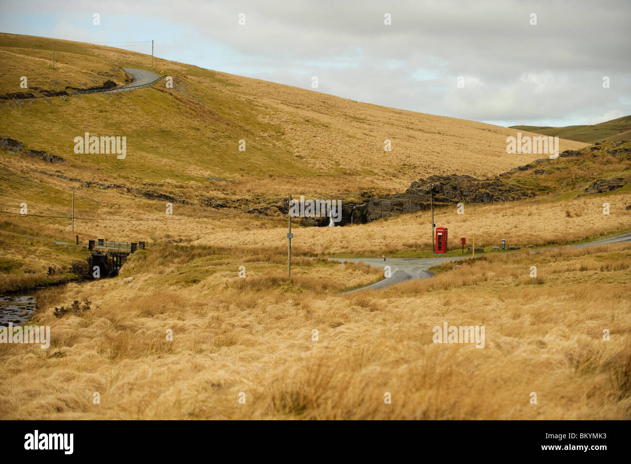 Remote red telephone box in upland Ceredigion mid wales uk - Stock Image
