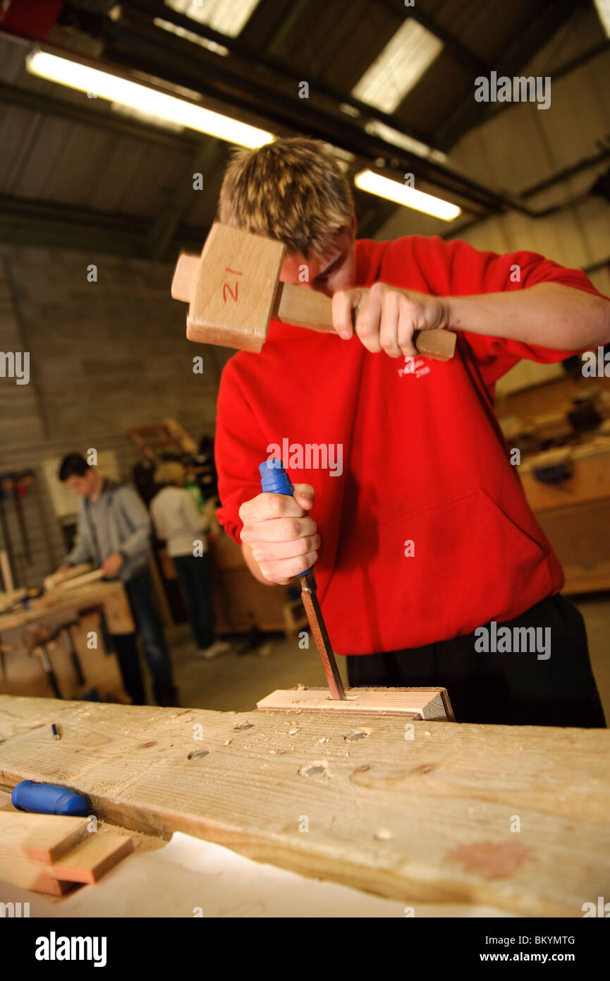Teenage boy learning woodworking skills at a vocational learning class Ceredigion Training, Aberystwyth Wales UK - Stock Image