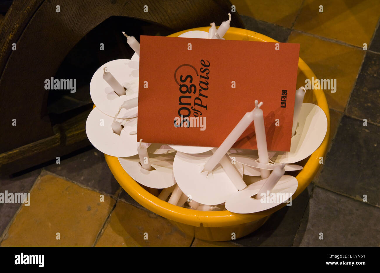 Bucket of candles and programme for BBC Songs of Praise at Hereford Cathedral - Stock Image