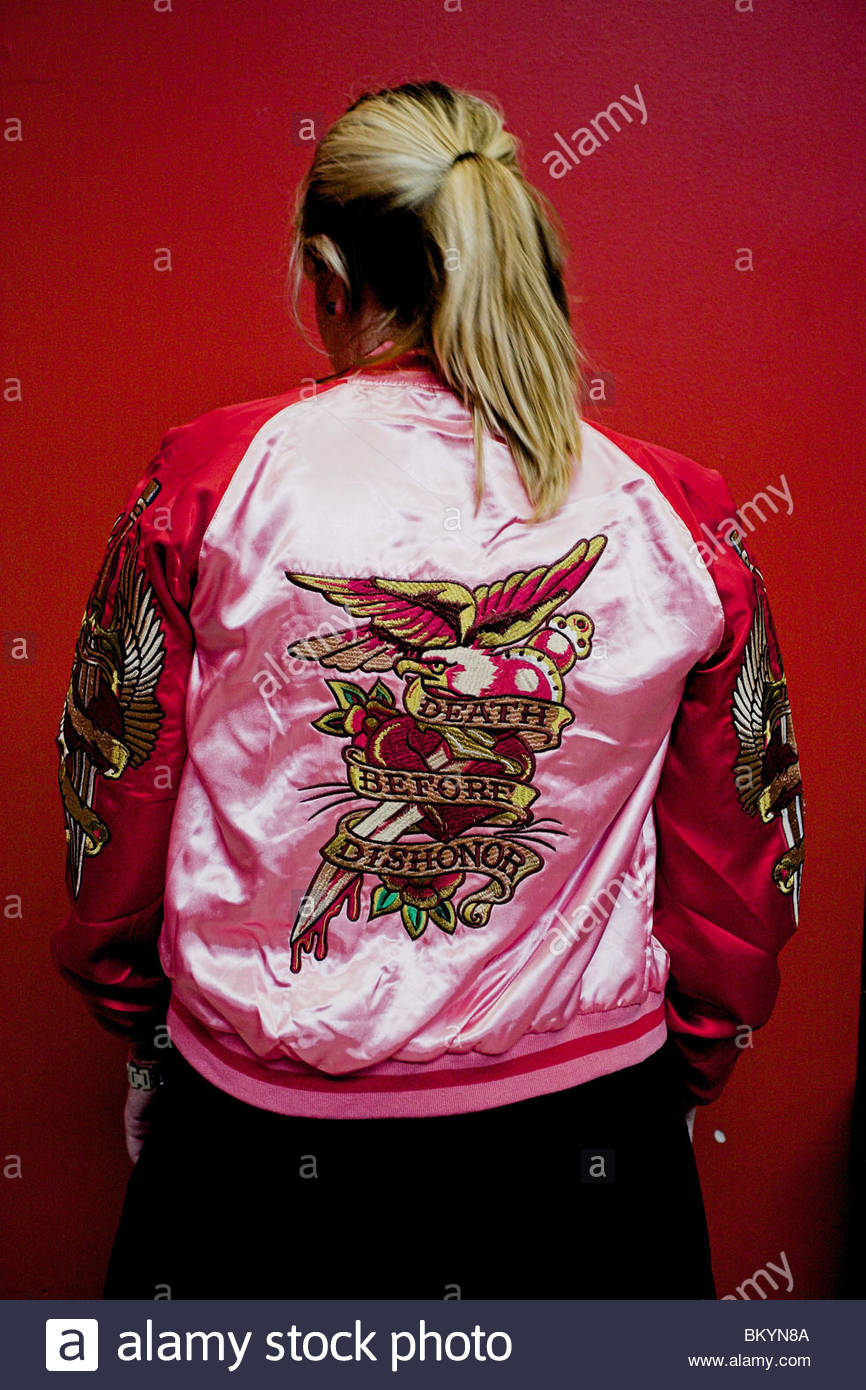 The back of a young women with a pink and red jacket that during a tattoo expo in Goteborg (Göteborg), Sweden. - Stock Image