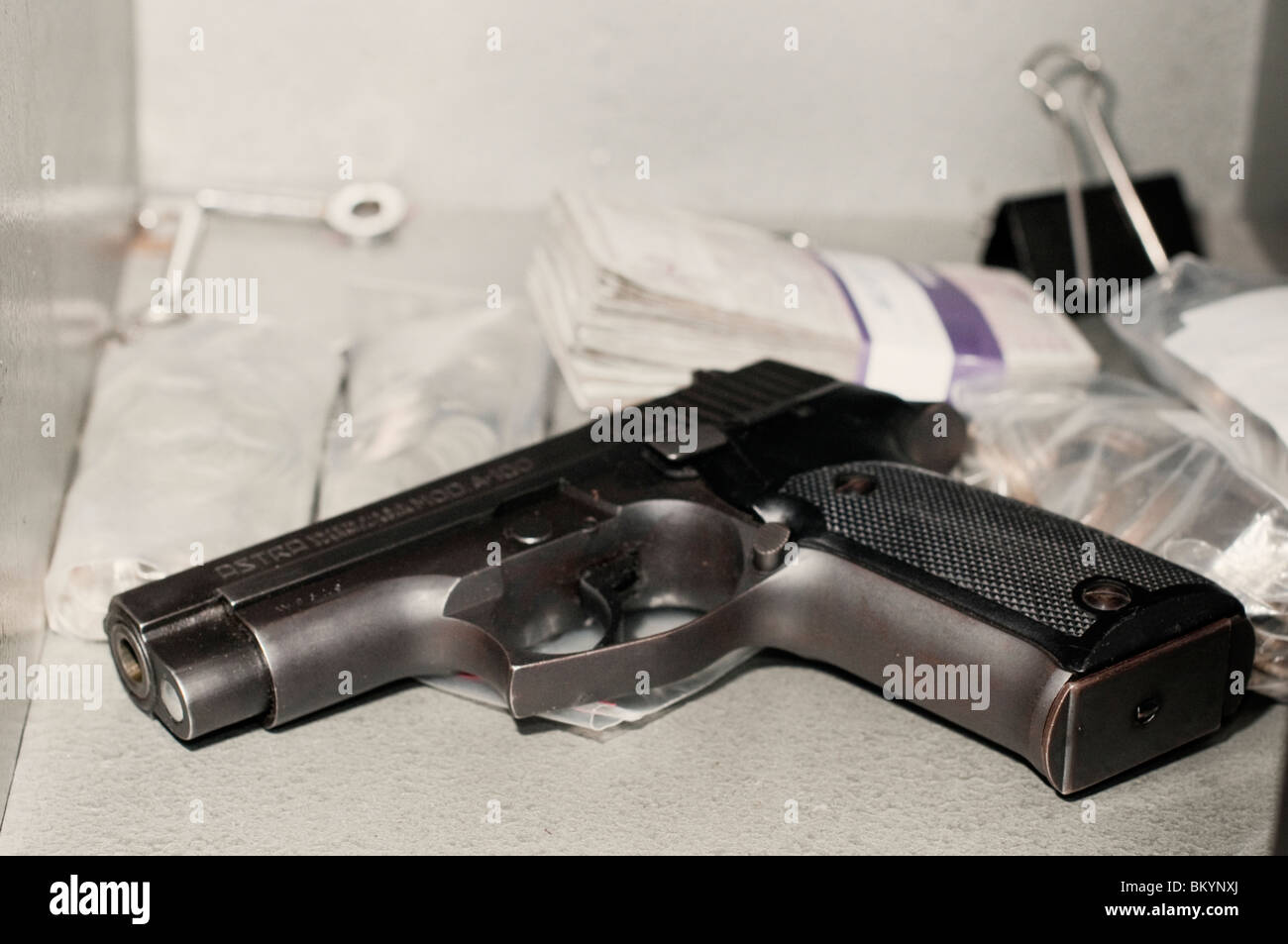 Handgun and valuables in secure safe - Stock Image