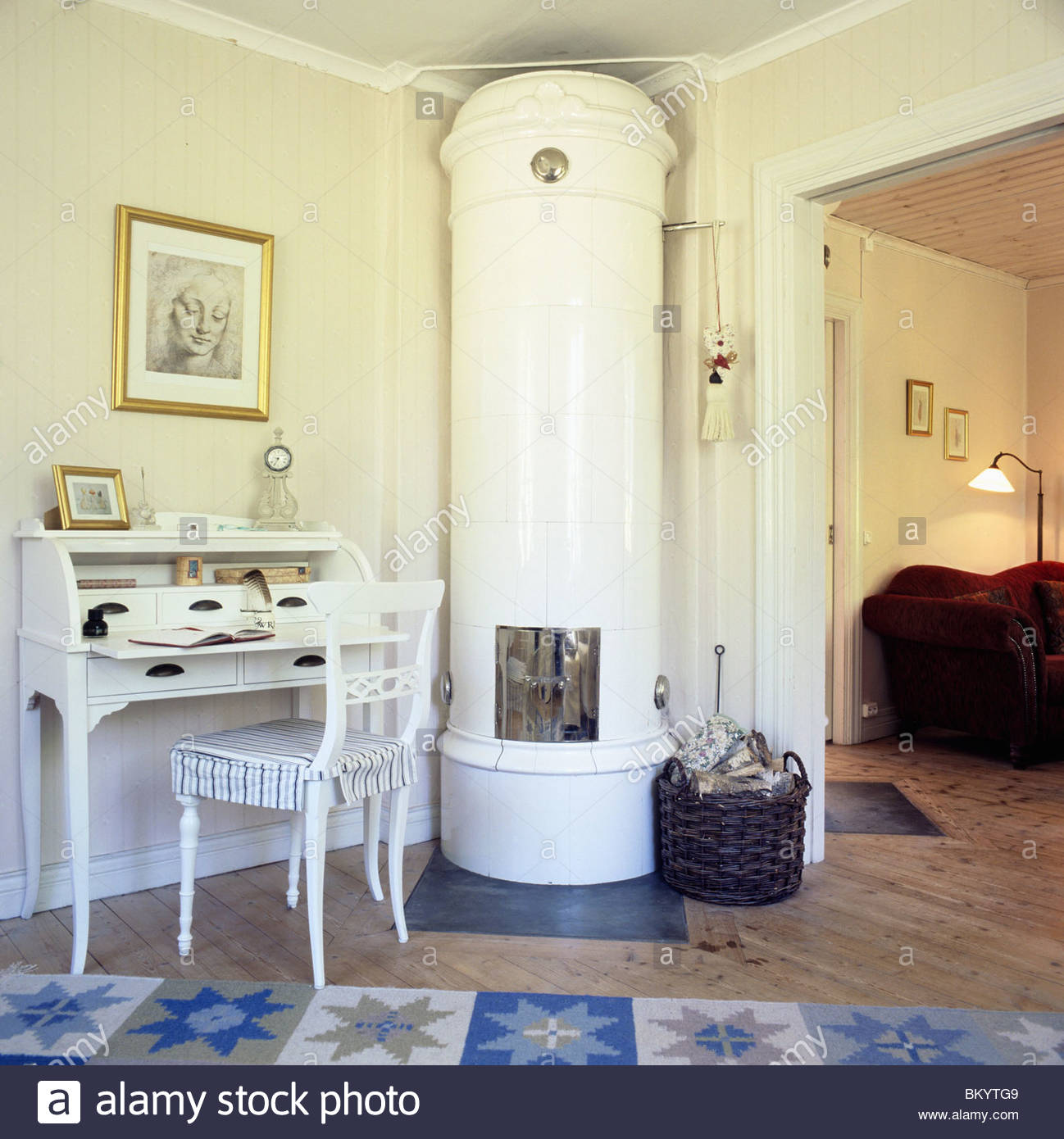 swedish tiled stove in a livingroom of a cottage with a traditional ...