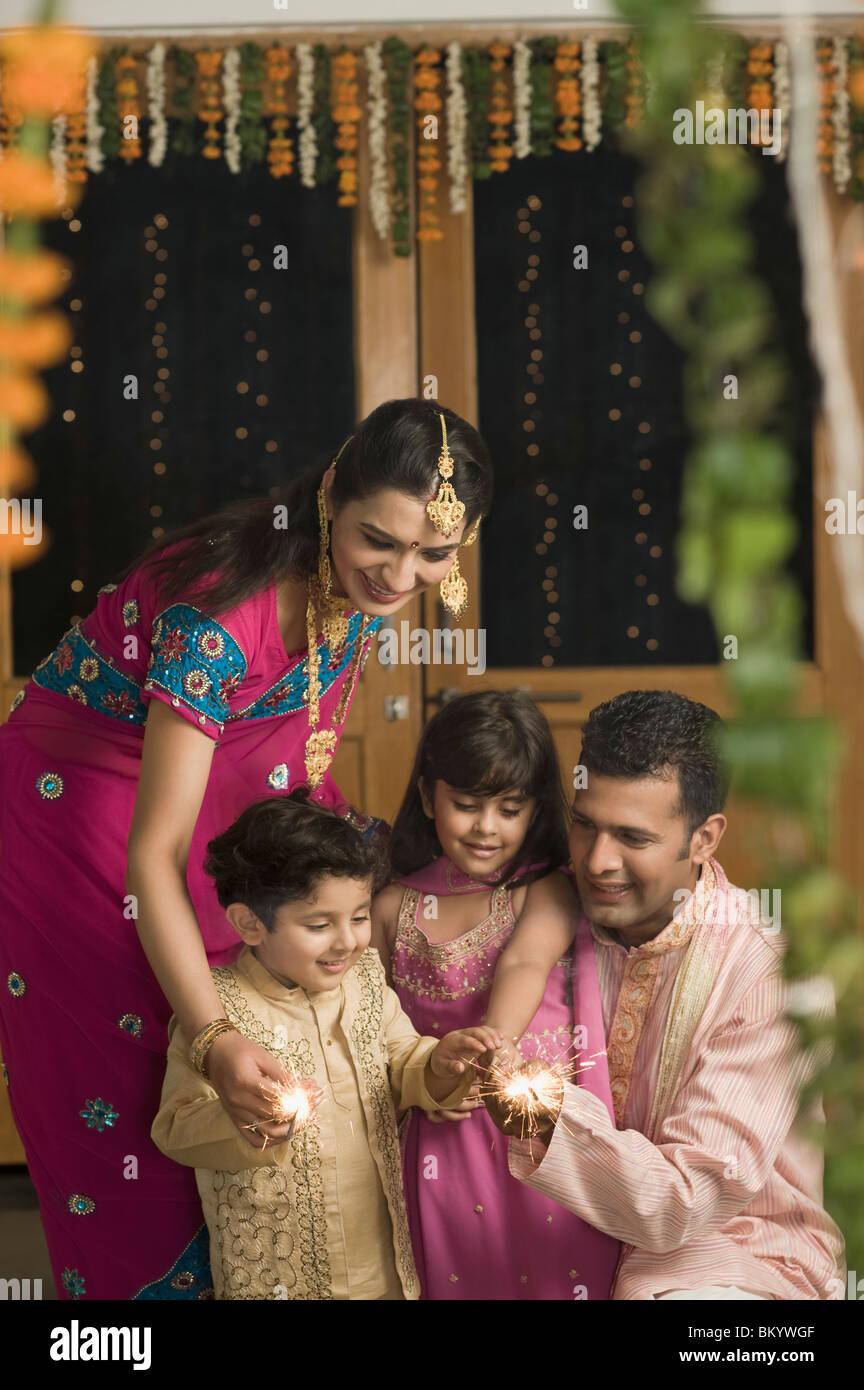 Family celebrating Diwali Stock Photo