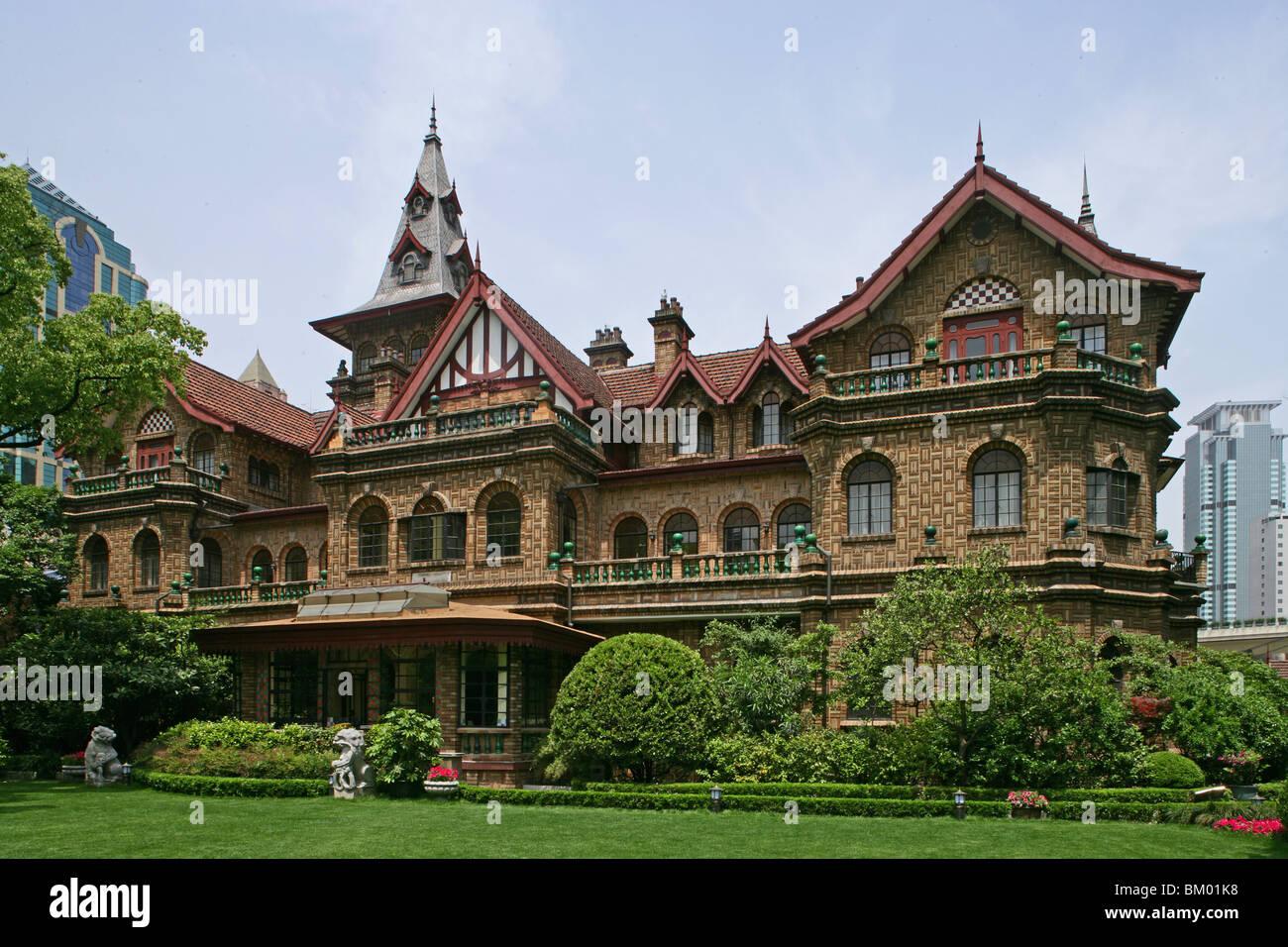 Moller Villa Hotel, fairytale gothic fantasy, brick building, 1936, Heng Shan group, garden - Stock Image