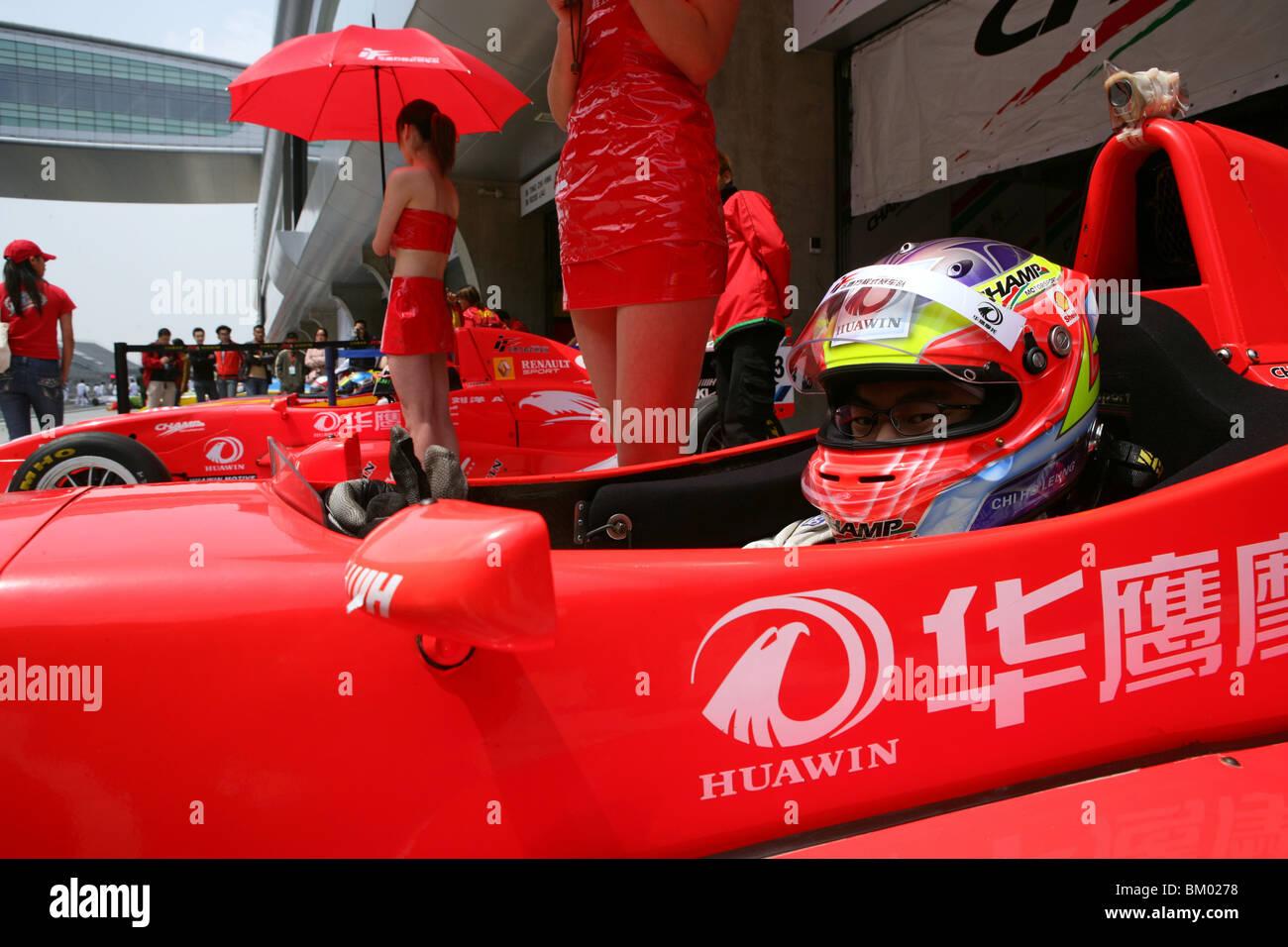 circuit race course, show gilrs, racing driver, circuit, racing car, formula, red - Stock Image