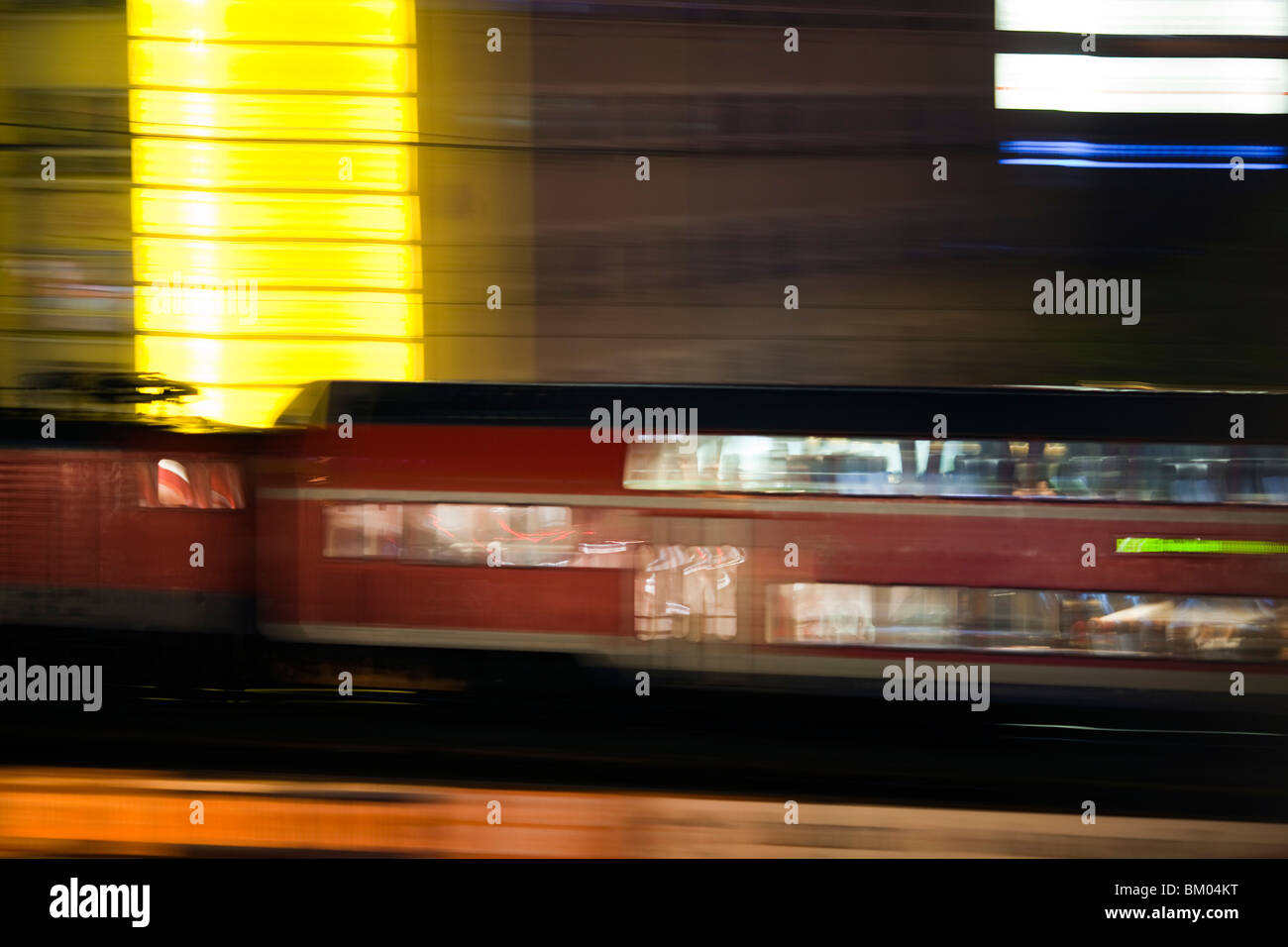 Panning shot of a train by night, Berlin, Germany - Stock Image