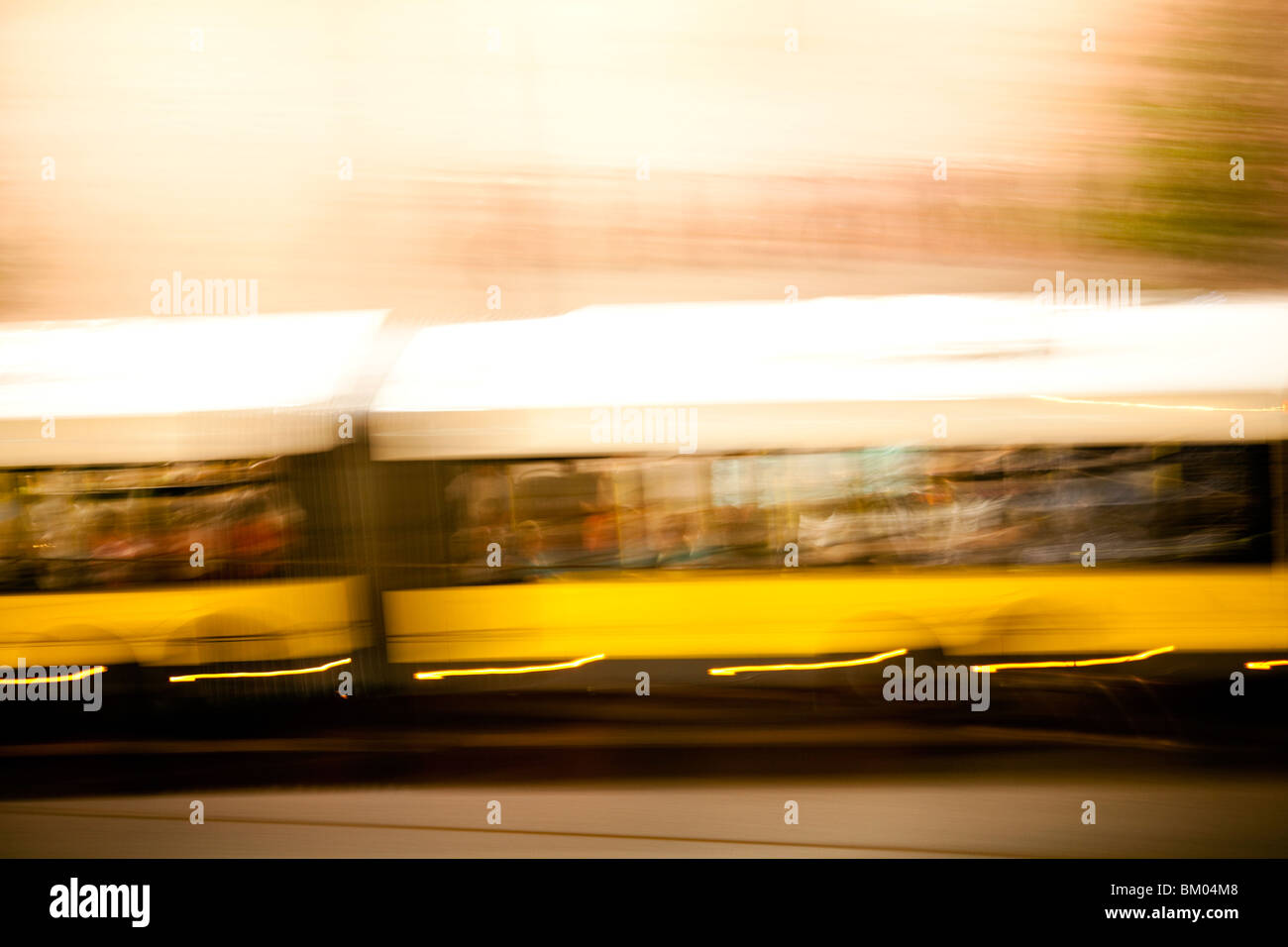 Panning shot of a tram by night, Berlin, Germany - Stock Image