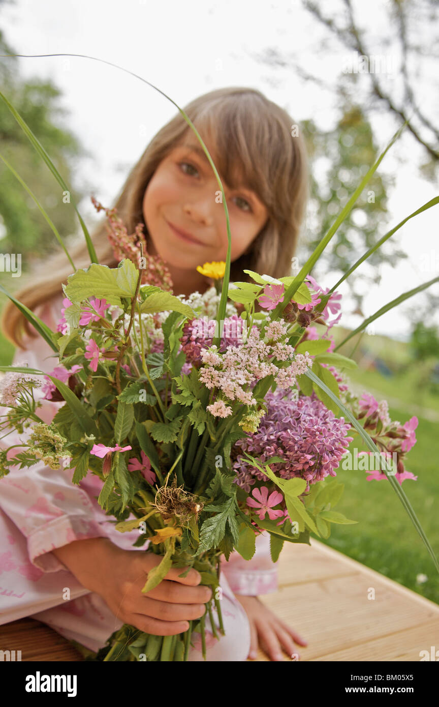Little girl with a bouquet of flowers Stock Photo