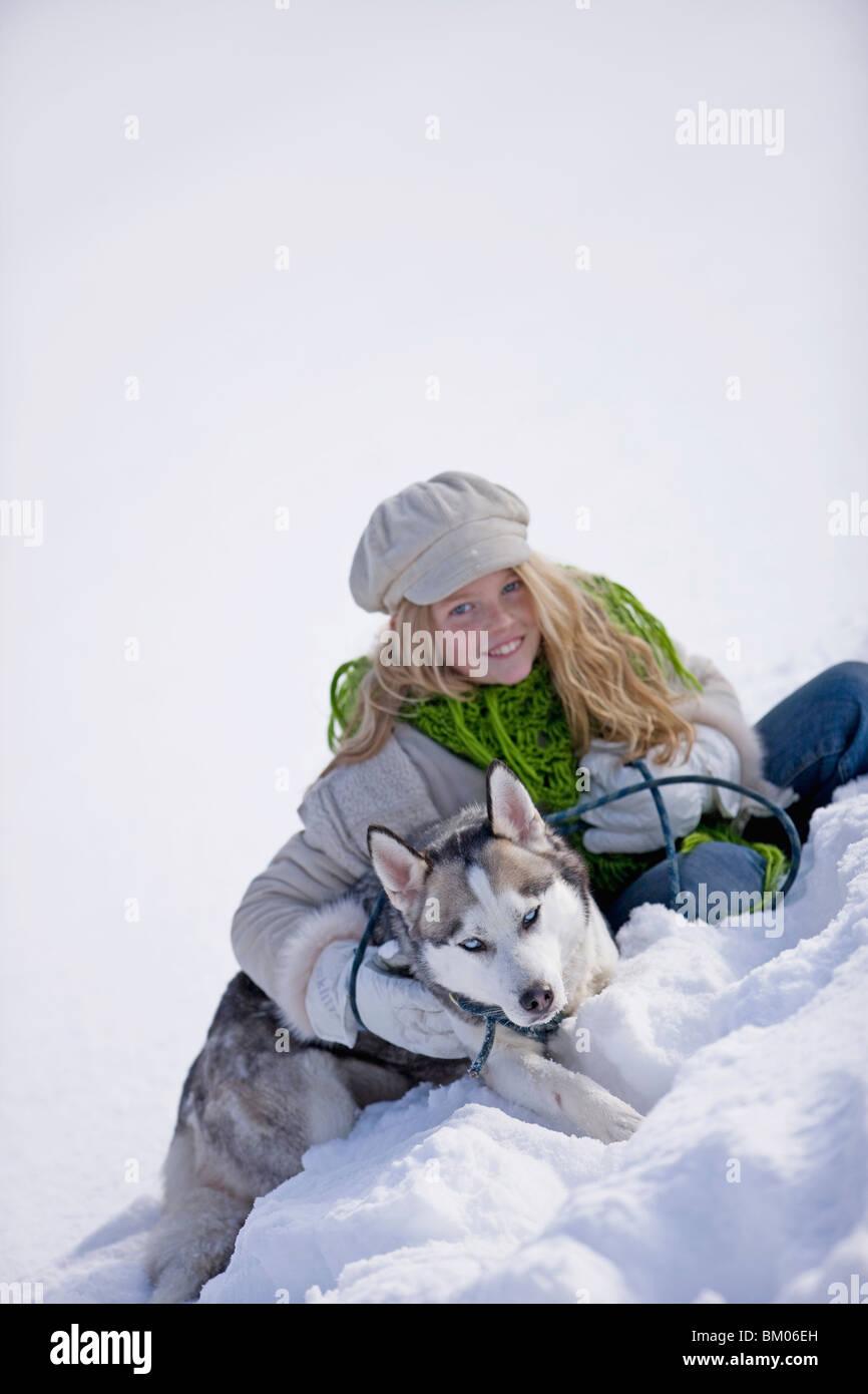 Girl and siberian husky - Stock Image