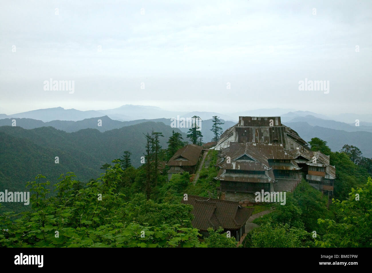 view over corrugated iron roofs of the Xixiang Chi monastery and temple, forest green, Elephant Bathing Pool, World - Stock Image