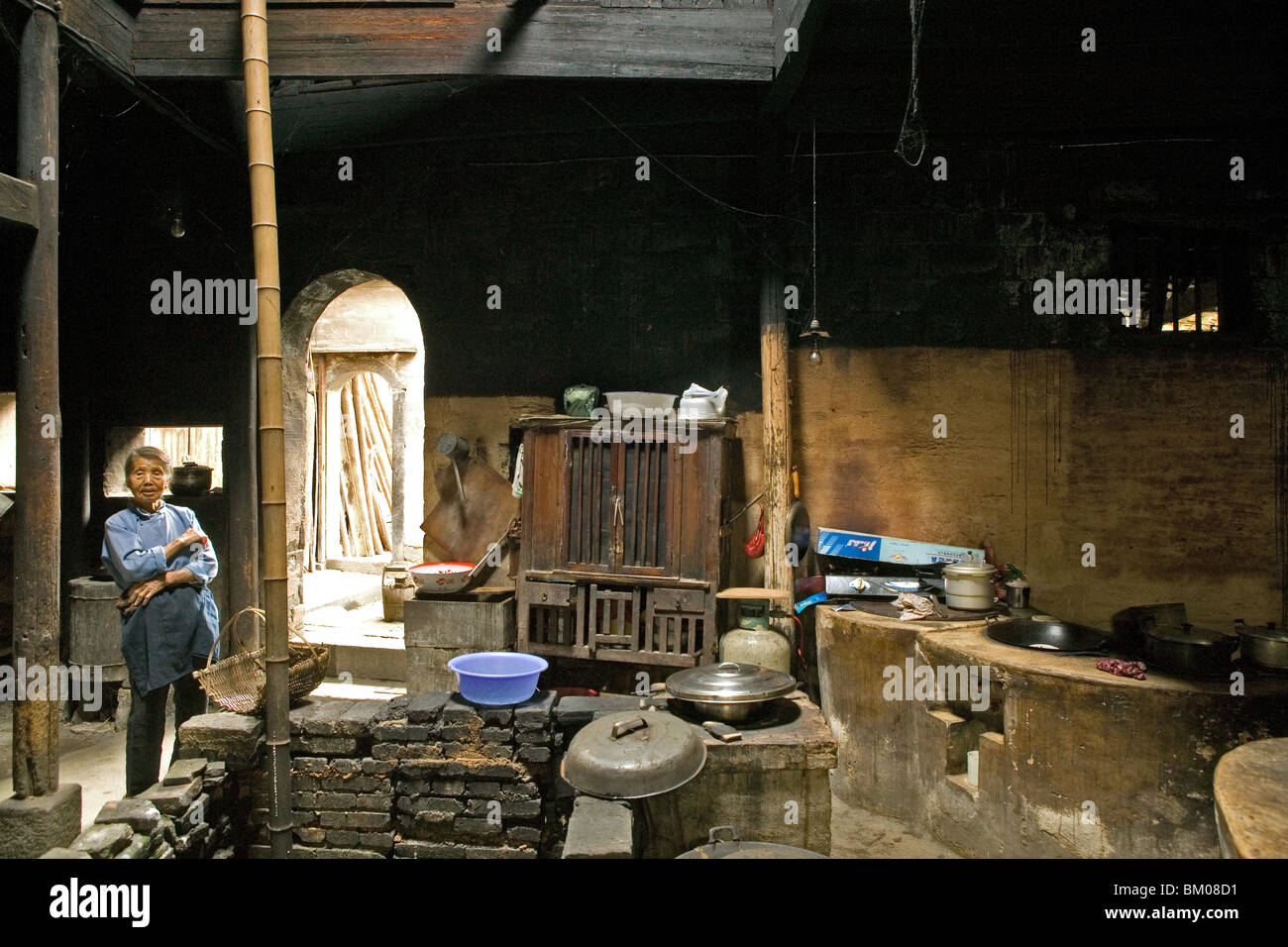 traditional kitchen, timber house in Chengkun, ancient village, living museum, China, Asia, World Heritage Site, - Stock Image