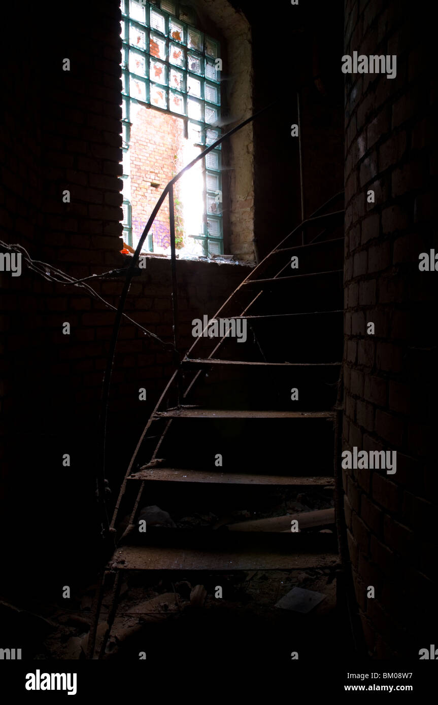 Old abandoned factory with metal staircase in Potsdam Berlin - Stock Image