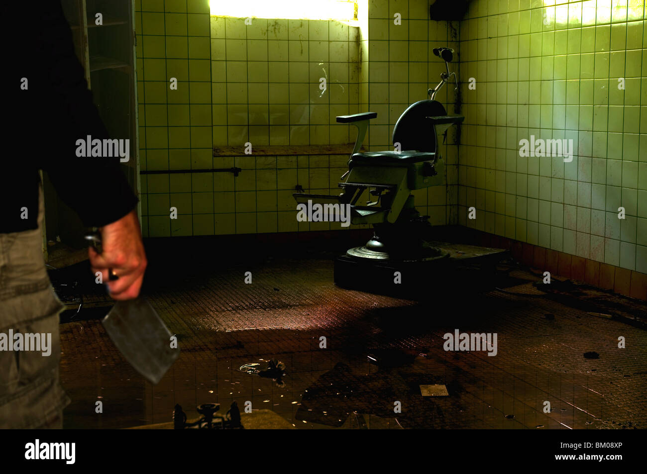 An old dentist chair in an abandoned Soviet hospital in East Germany - Stock Image