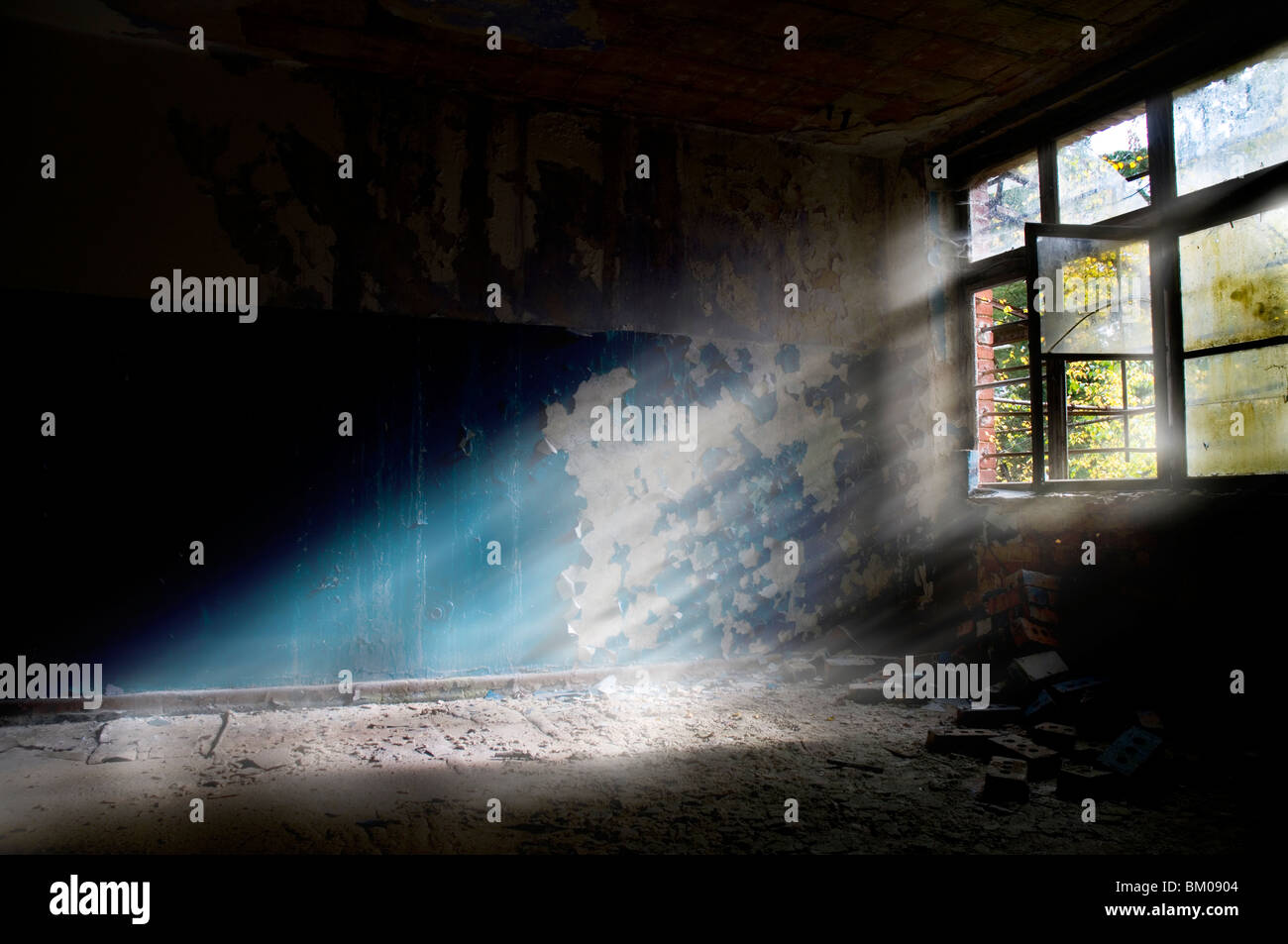 Sunlight shining through an old broken window - Stock Image