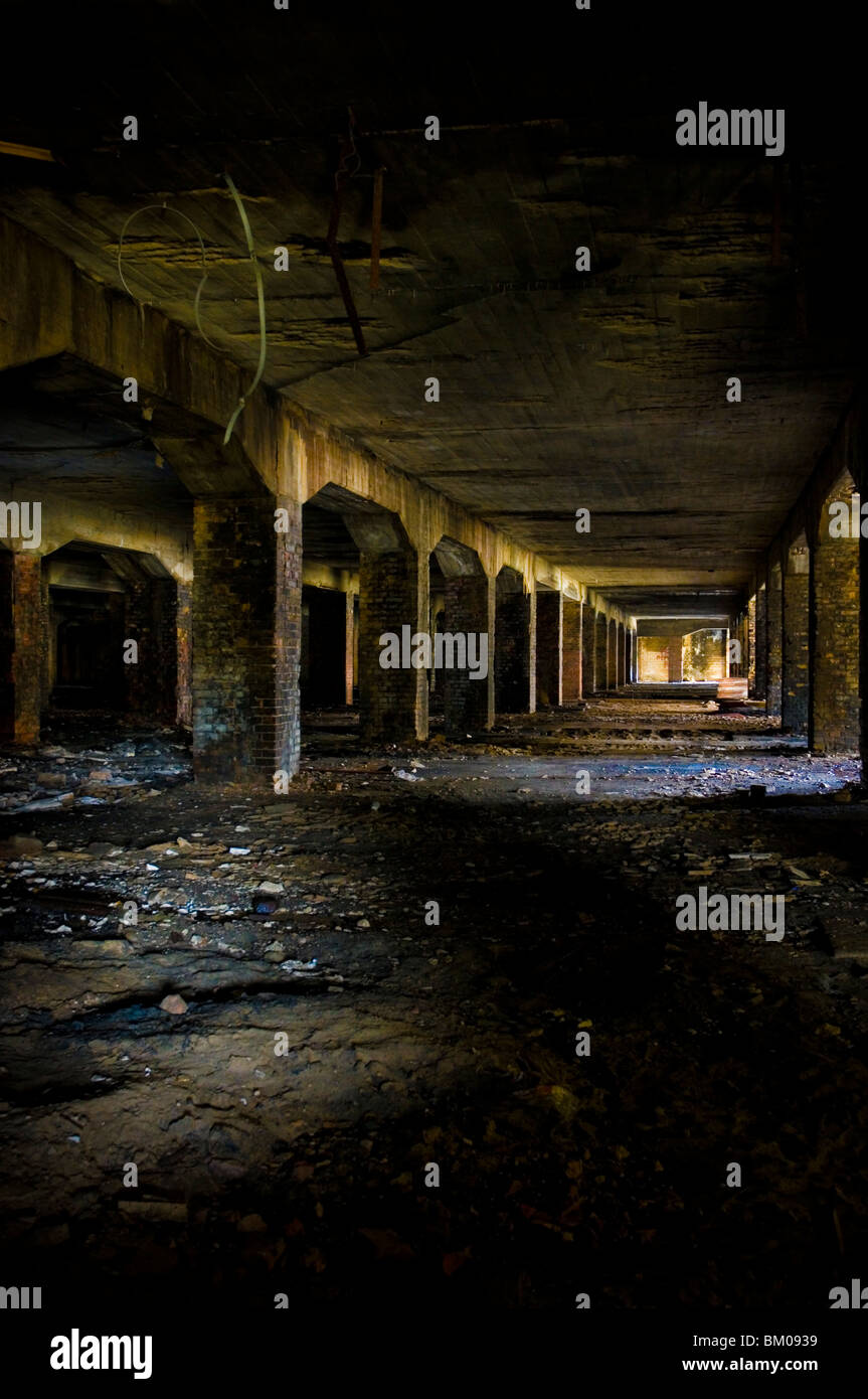 Derelict coal bunker in large building - Stock Image