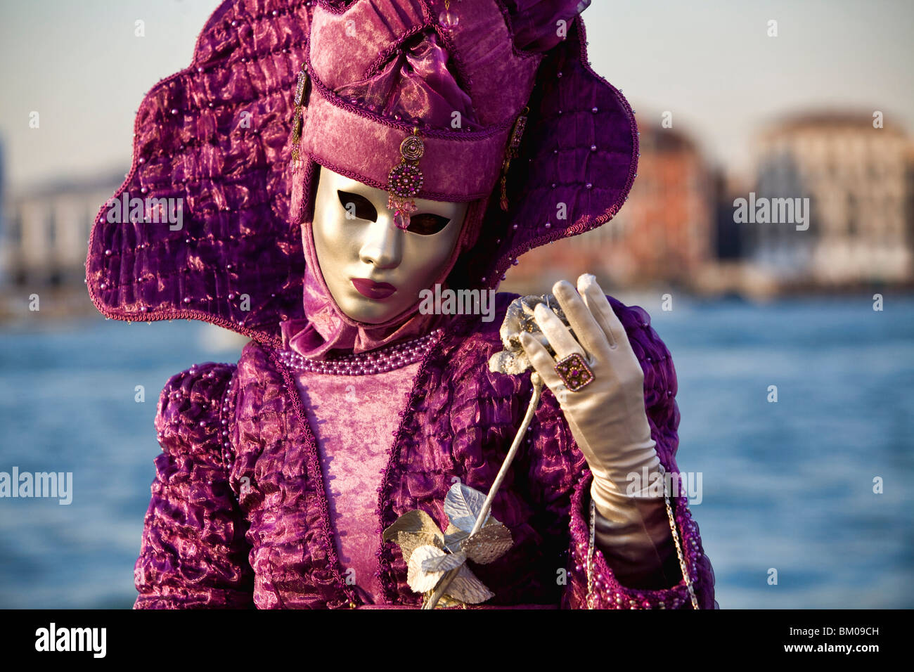 Woman wearing a costume in Carnival in Venice Stock Photo
