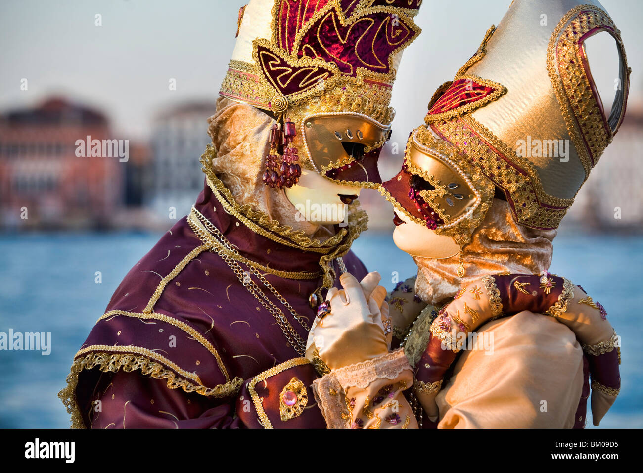 Couple wearing costumes embracing at Carnival in Venice, Italy Stock Photo