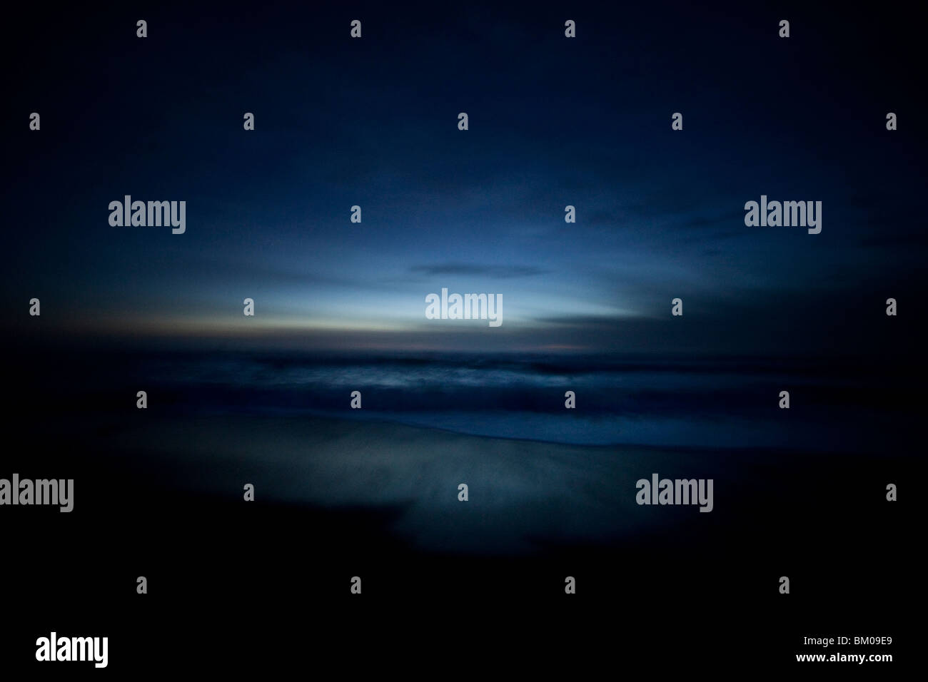Ocean at night in Cambria, California USA - Stock Image