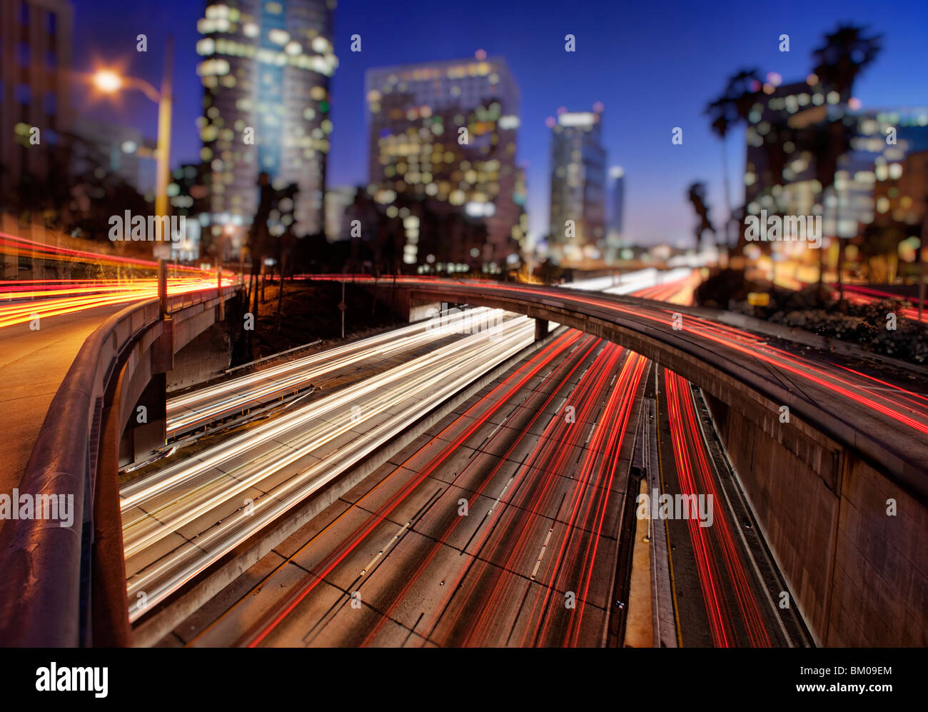 Car trails of the freeways of downtown Los Angeles at night - Stock Image