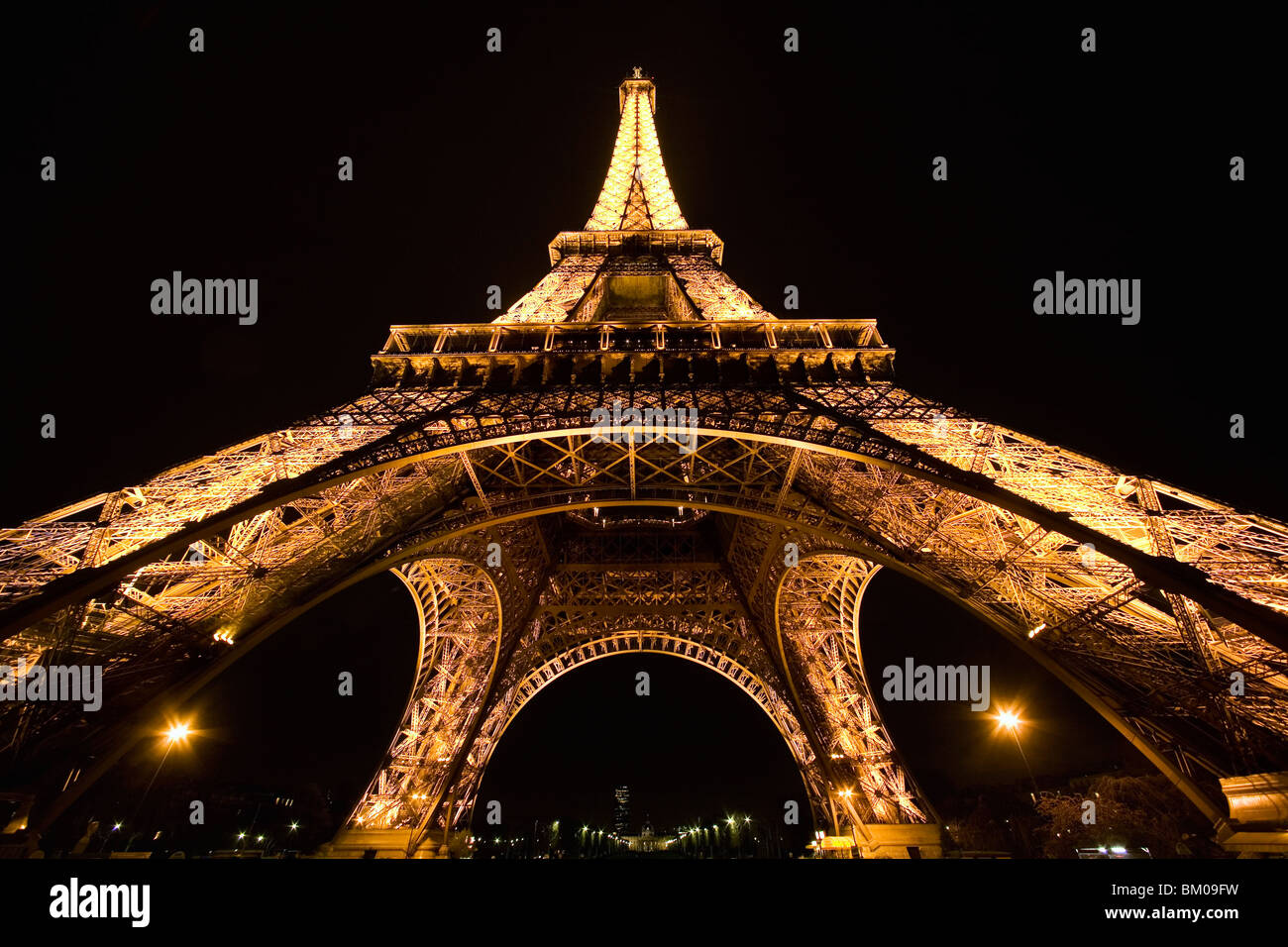 Wide angle view of the Eiffel Tower at night from below with illuminations Stock Photo