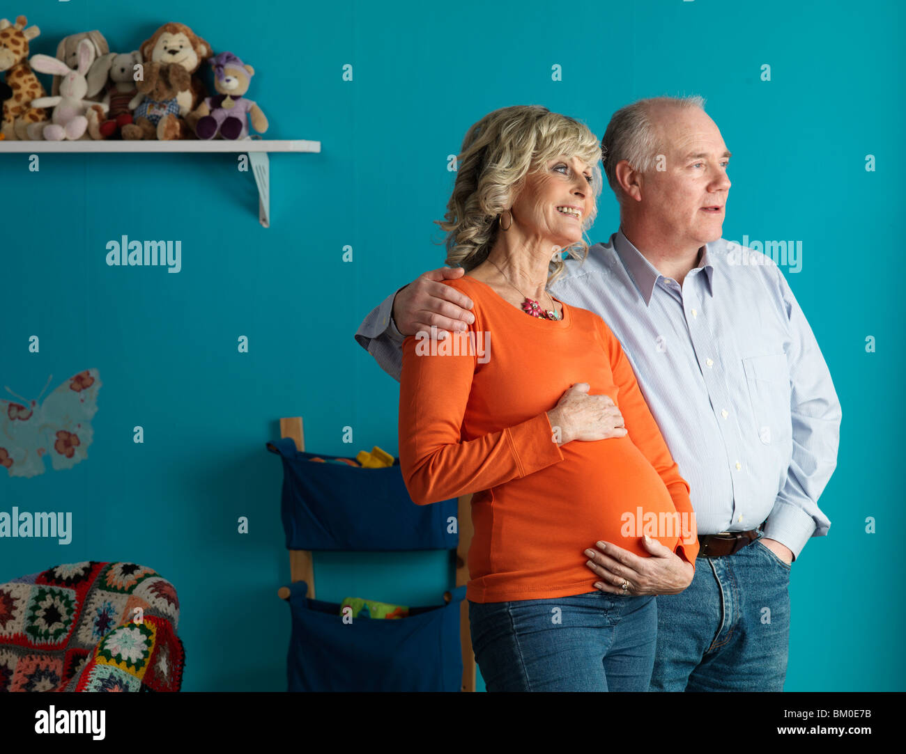 Pregnant older woman with male partner - Stock Image
