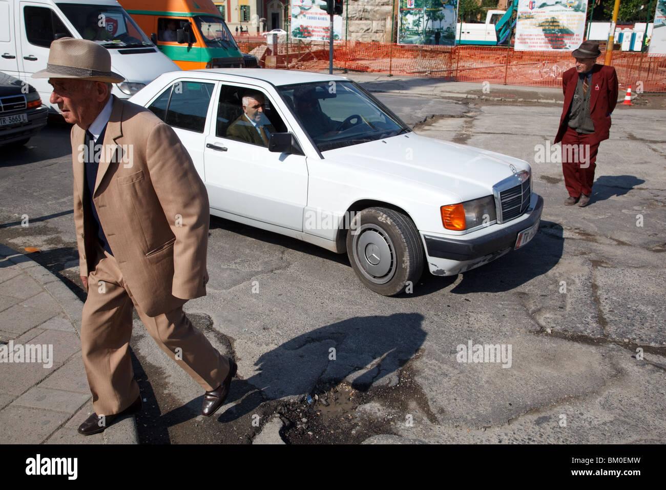elegant old men and Mercedes 190 car in Tirana, the capital of Albania. - Stock Image