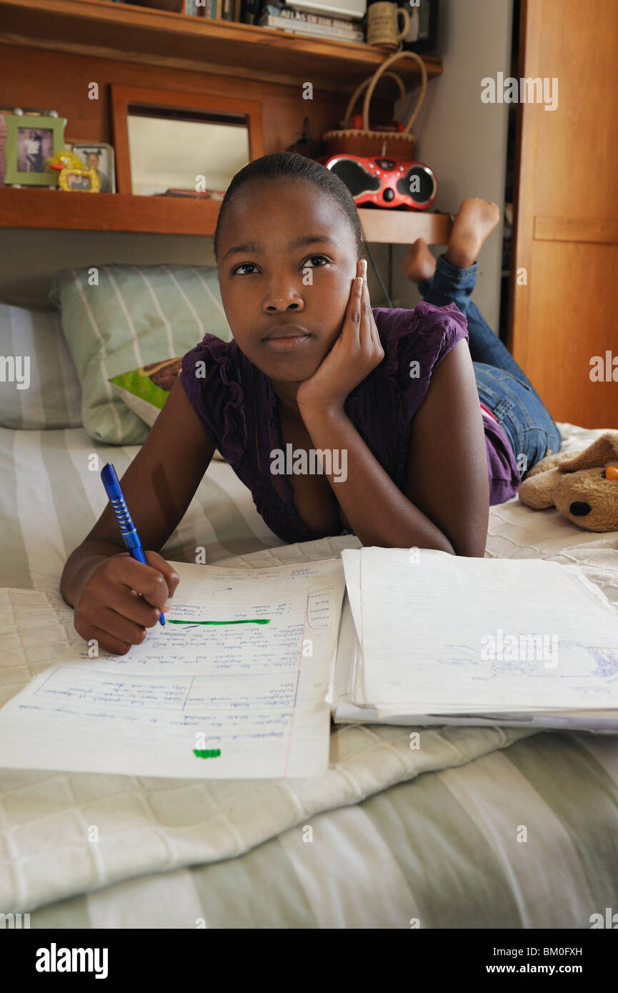 Teenage girl (16-17) doing homework, Cape Town, Western Cape Province, South Africa - Stock Image
