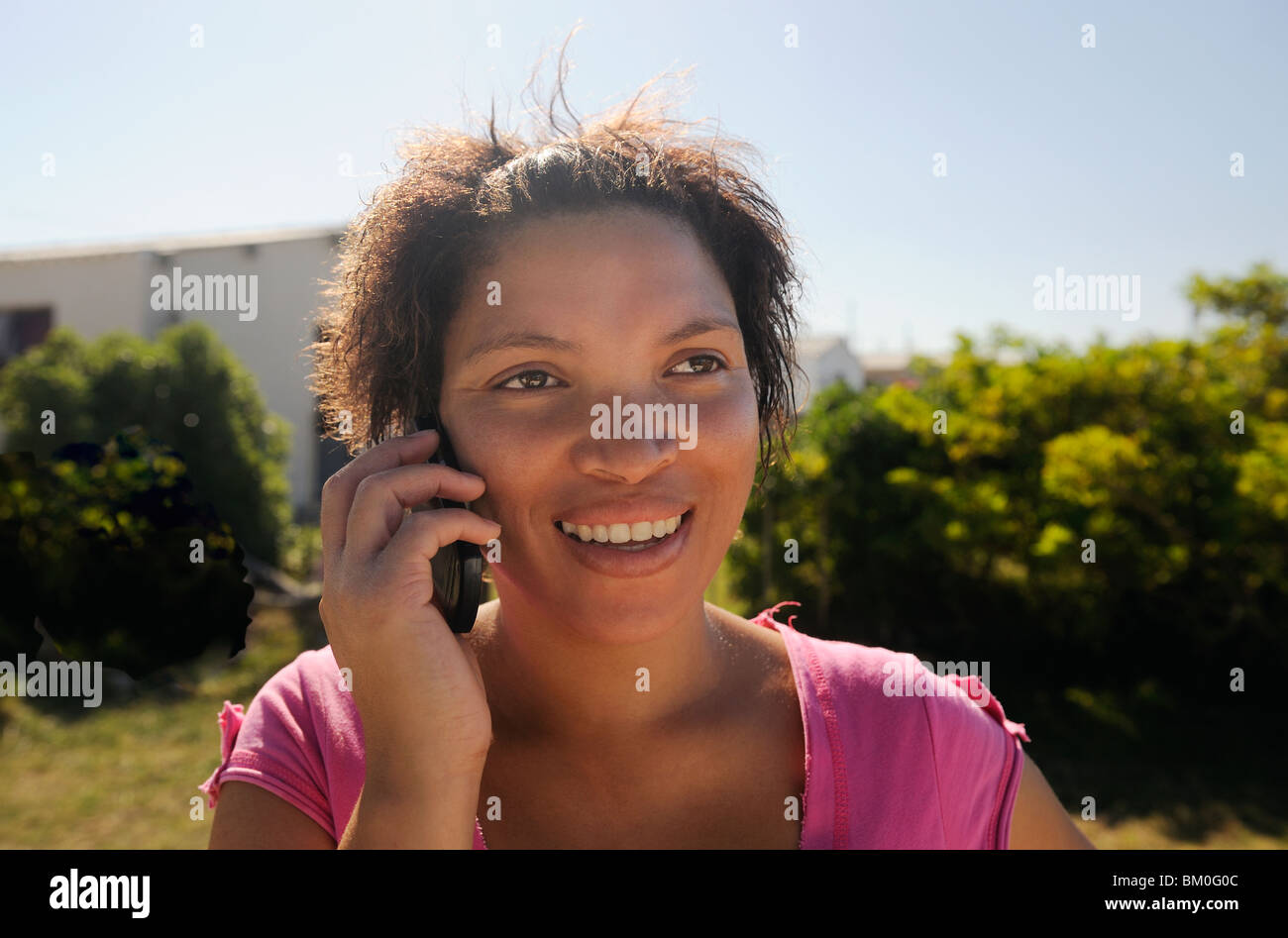 Woman using mobile phone, St Francis Bay, Sea Vista, Eastern Cape Province, South Africa - Stock Image