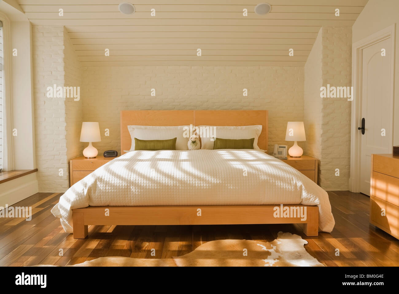 Master Bedroom with King-Size Bed in Luxurious Home - Stock Image