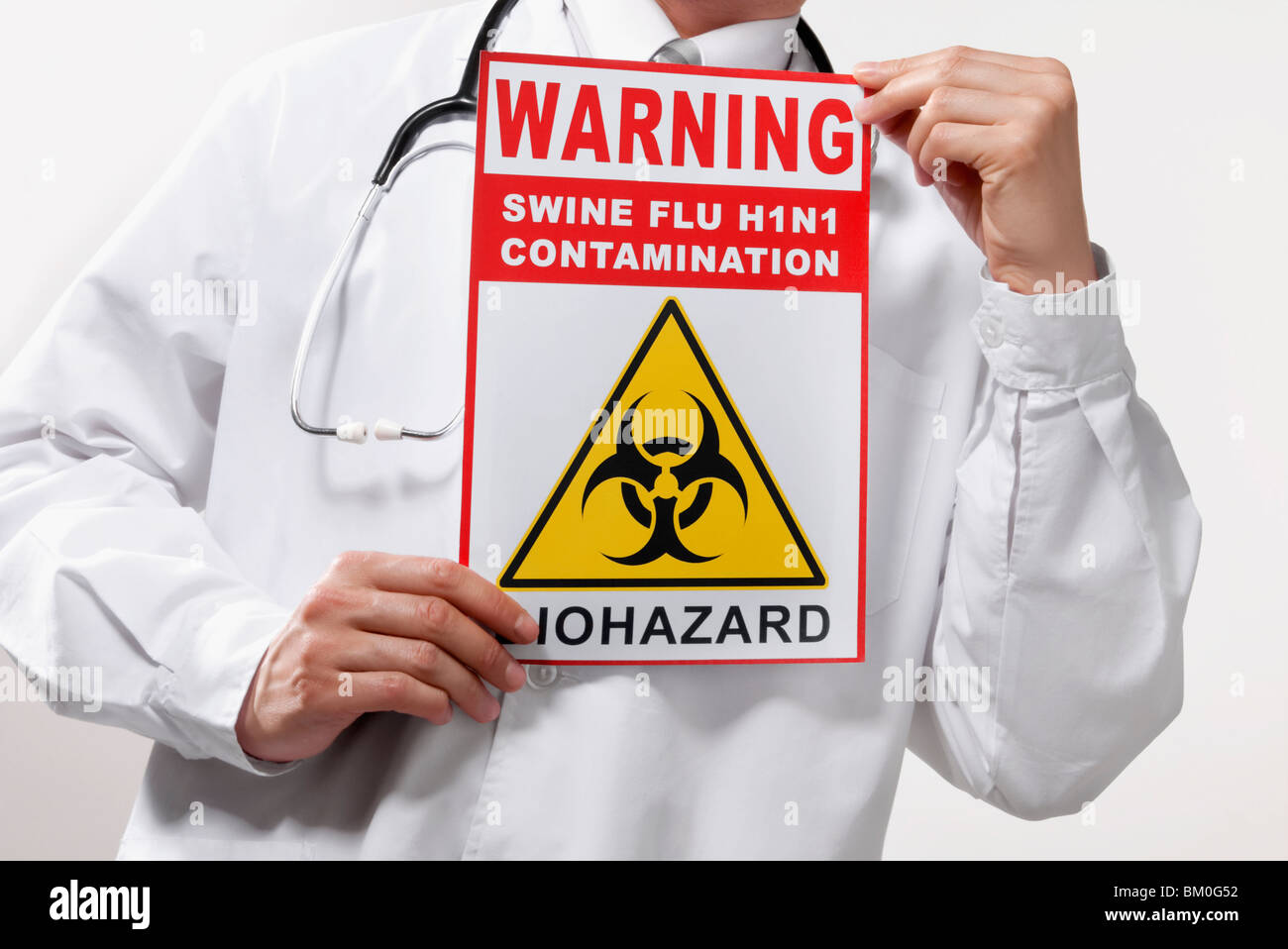 Doctor showing a Biohazard warning sign - Stock Image