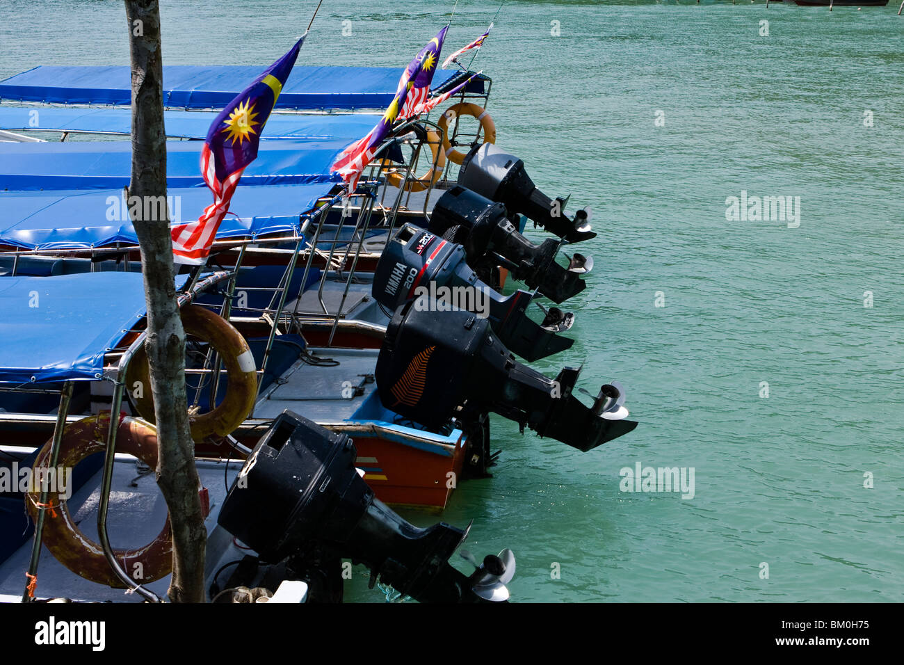 Outboard motors on Langkawi tourist boats - Stock Image
