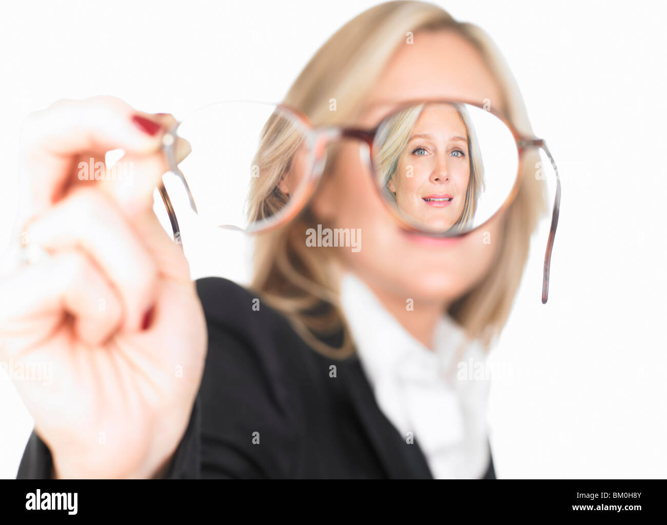 Portrait of a woman trough glasses - Stock Image