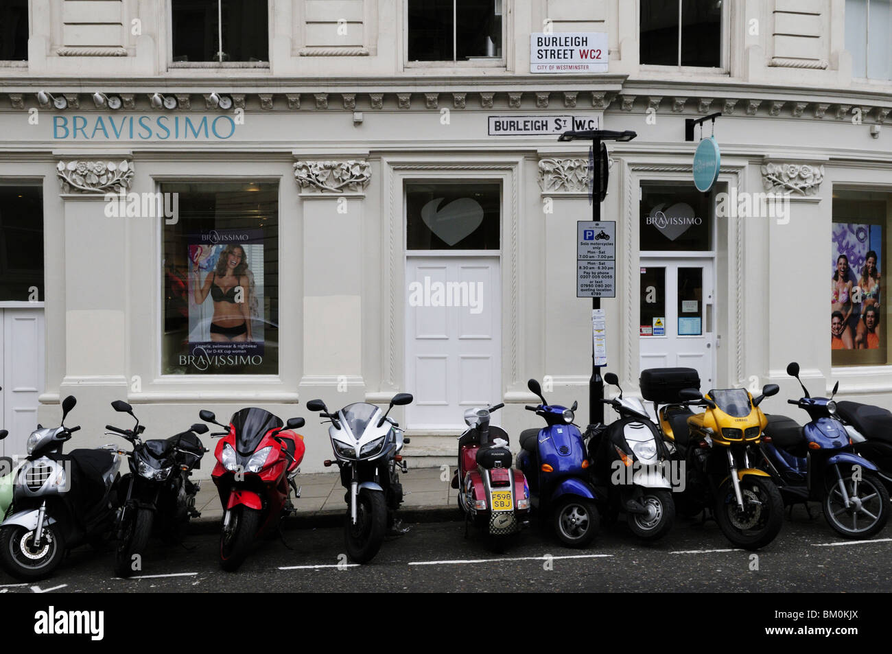 Scooters Parked outside Bravissimo, Burleigh Street, Westminster, London, England, UK - Stock Image