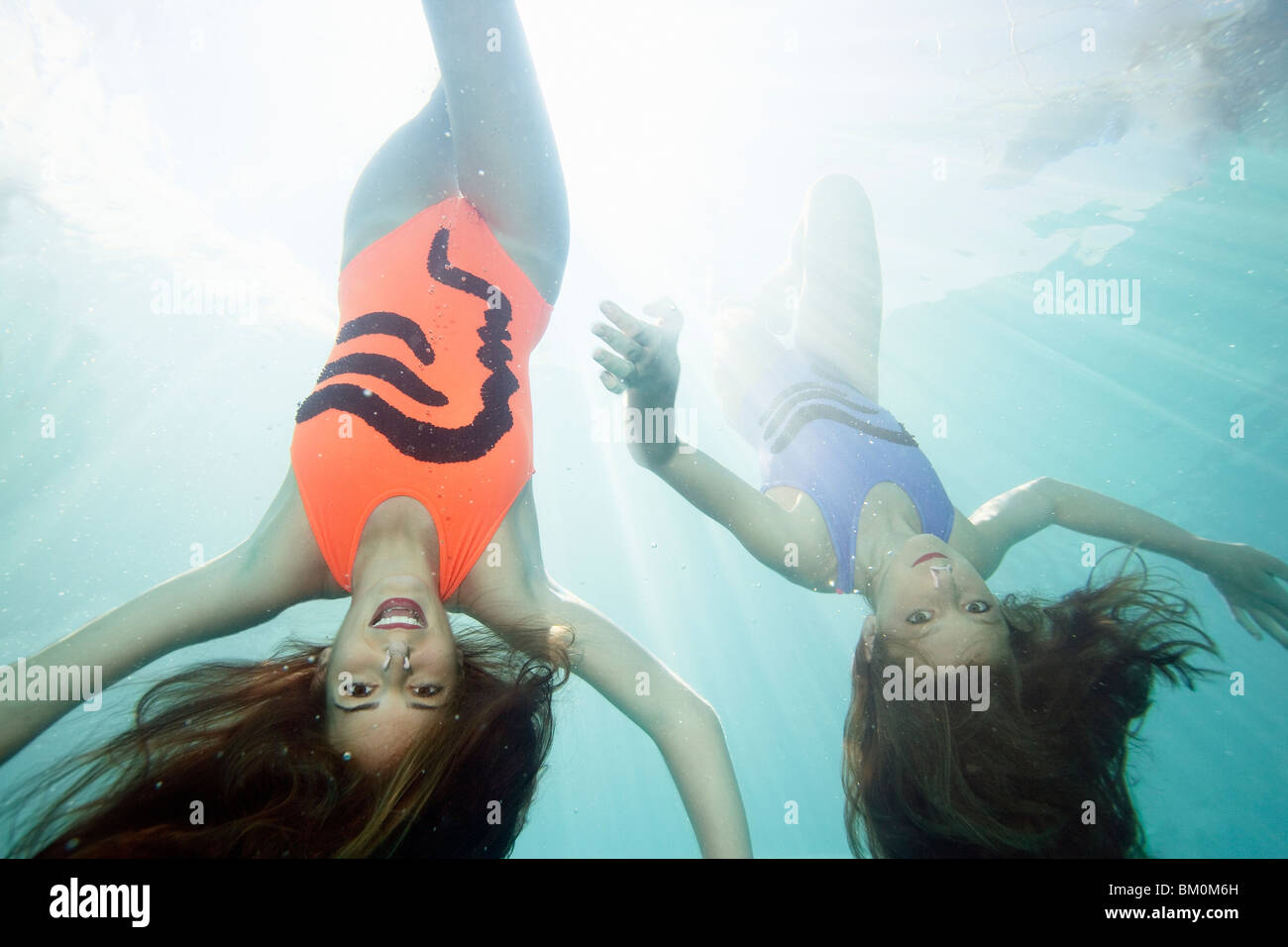 Synchronized swimmers underwater - Stock Image