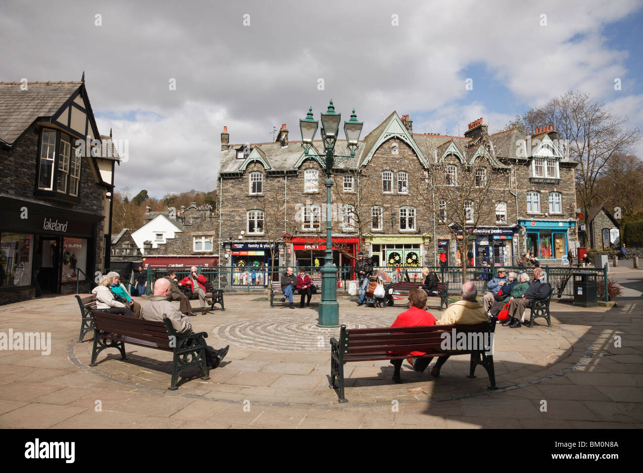 Market Cross, Ambleside, Cumbria, England, UK, Britain. People sitting in the town square - Stock Image