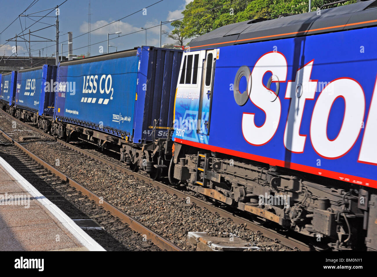 Stobart Rail locomotive No. 92017 'Bart the Engine' hauling Tesco Less CO2 freight. West Coast Main Line. - Stock Image