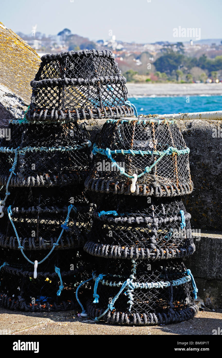 crab pots on the harbour at newlyn near penzance in cornwall, uk - Stock Image