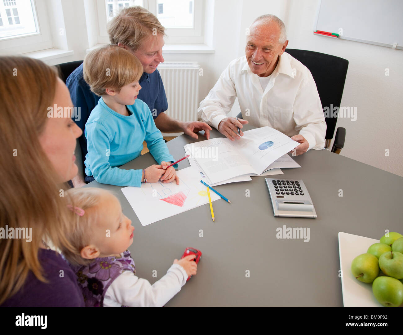 Advisor discussing papers with a family Stock Photo